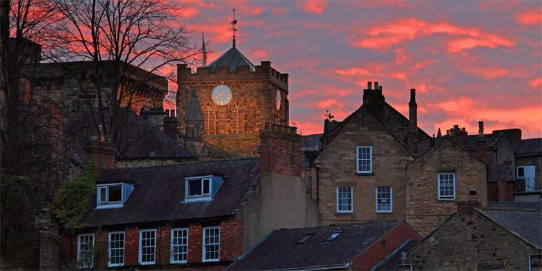 Sunset behind the abbey and town of Hexham, Northumberland