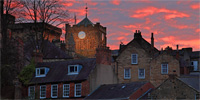 Photograph Sunset behind the abbey and town of Hexham, Northumberland